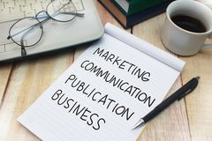 Marketing Communication Publication Business, Motivational Words. Marketing Communication Publication Business words letter, written on notepad, work desk top royalty free stock image