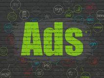 Marketing concept: Ads on wall background. Marketing concept: Painted green text Ads on Black Brick wall background with Scheme Of Hand Drawn Marketing Icons royalty free stock images