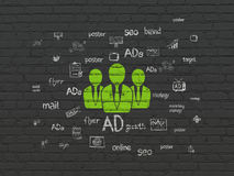 Marketing concept: Business People on wall. Marketing concept: Painted green Business People icon on Black Brick wall background with  Hand Drawn Marketing Icons Royalty Free Stock Photos