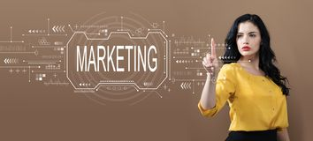 Marketing concept with business woman. On a brown background stock photography
