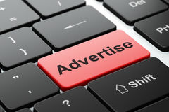 Marketing concept: Advertise on computer keyboard background. Marketing concept: computer keyboard with word Advertise, selected focus on enter button background Royalty Free Stock Images