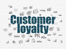 Marketing concept: Customer Loyalty on wall background. Marketing concept: Painted blue text Customer Loyalty on White Brick wall background with  Hand Drawn Royalty Free Stock Photos