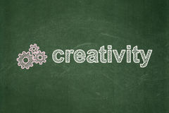 Marketing concept: Gears and Creativity on. Marketing concept: Gears icon and text Creativity on Green chalkboard background, 3d render Royalty Free Stock Image