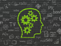 Marketing concept: Head With Gears on wall background Royalty Free Stock Images