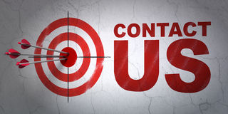 Marketing concept: het doel en contacteert ons op muur Royalty-vrije Stock Foto
