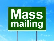 Marketing concept: Mass Mailing on road sign background. Marketing concept: Mass Mailing on green road highway sign, clear blue sky background, 3D rendering royalty free illustration