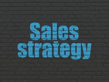 Marketing concept: Sales Strategy on wall background stock image