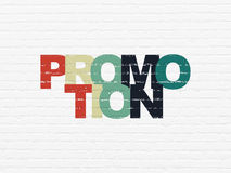 Marketing concept: Promotion on wall background Stock Photos