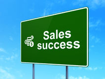 Marketing concept: Sales Success and Calculator on. Marketing concept: Sales Success and Calculator icon on green road (highway) sign, clear blue sky background Stock Photos