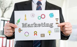 Marketing concept shown by a businessman stock photos