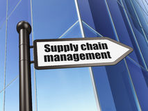 Marketing concept: Supply Chain Management on Building backgroun Stock Photo