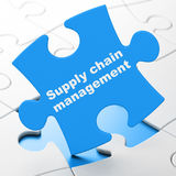 Marketing concept: Supply Chain Management on puzzle background Royalty Free Stock Photography