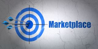 Marketing concept: target and Marketplace on wall background. Success marketing concept: arrows hitting the center of target, Blue Marketplace on wall background Stock Images