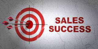 Marketing concept: target and Sales Success on wall background. Success marketing concept: arrows hitting the center of target, Red Sales Success on wall Royalty Free Stock Image
