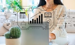Marketing concept with woman using her laptop. In her home office royalty free stock images