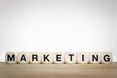 Marketing concept: the word Marketing spelled out. Marketing concept: the word Marketing spelled by toy dice royalty free stock photos
