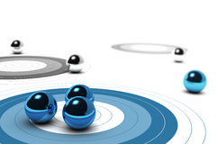 Marketing Core Target Concept. Three targets, one blue and other are grey, three balls over the first one concept of target market over white background Stock Photo