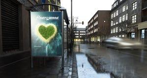 Marketing der Anschlagtafelflitterwochen-Werbung auf Stadt am Abend stockfoto