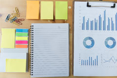 marketing graph and chart report with notebook, sticky note, pap Stock Photography