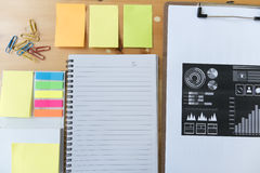marketing graph and chart report with notebook, sticky note, pap Royalty Free Stock Images