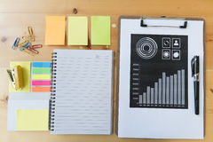marketing graph and chart report with pen, notebook, sticky note Stock Photography