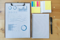 marketing graph and chart report with pen, notebook, sticky note Stock Images