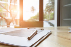 Marketing graph and chart report with pen on office desk of fina Stock Photo