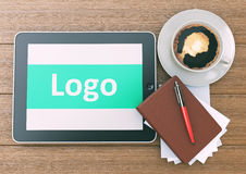 Marketing Logo Concept on tablet pc computer with cup of coffee, Stock Photography