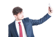 Marketing manager wearing suit taking a selfie Royalty Free Stock Photos