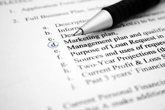 Marketing plan. Close up of pen on marketing plan royalty free stock photos