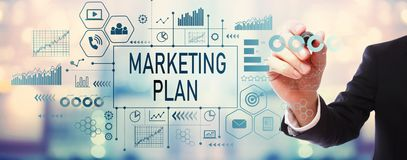 Marketing plan with businessman. On blurred abstract background stock photo