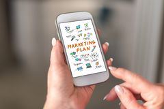 Marketing plan concept on a smartphone. Held by a hand stock images