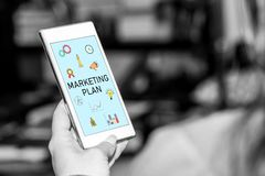 Marketing plan concept on a smartphone. Smartphone screen displaying a marketing plan concept stock photos