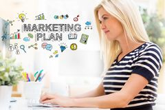 Marketing Plan with happy young woman in front of the computer Stock Photos