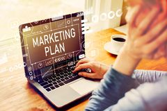 Marketing plan with man using a laptop. Computer stock images