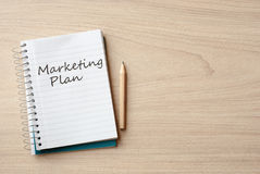 Marketing plan. On notebook on desk royalty free stock images