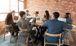 Marketing plan researching. Business team discussing new working strategy in loft office, copy space stock images