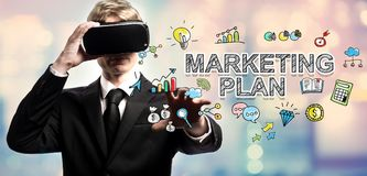 Marketing Plan text with businessman using a virtual reality Royalty Free Stock Photo