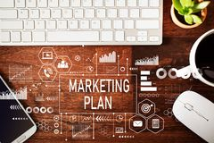 Marketing Plan with workstation. On a wooden desk royalty free stock photography