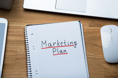 Marketing Plan Written On Notepad At Office Desk Royalty Free Stock Photos