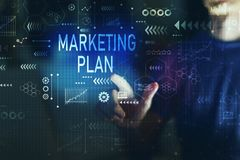 Marketing plan with young man. Touching screen at night stock photo