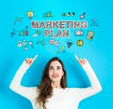 Marketing Plan with young woman looking upwards. Marketing Plan with young woman reaching and looking upwards Royalty Free Stock Image