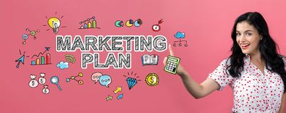 Marketing plan with young woman. On a pink background royalty free stock photos