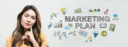 Marketing plan with young woman. In a thoughtful fac royalty free stock images