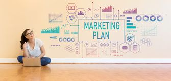Marketing plan with young woman using a laptop computer. On floor royalty free stock image