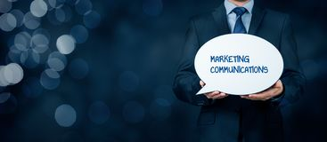 Marketing communications concept. Marketing specialist with marketing communications text on speech bubble Stock Image