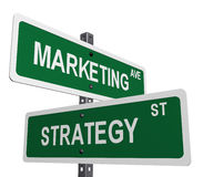 Marketing and strategy. A sign post with marketing and strategy on street like signs Royalty Free Stock Photo