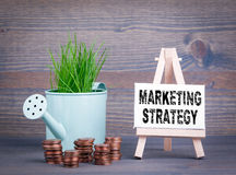 Marketing Strategy, Business Concept. Miniature watering pot with fresh green spring grass and small change Royalty Free Stock Images