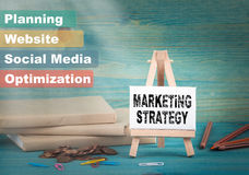 Marketing strategy, business and strategic concept. notice board by the books and money, and notifications.  Stock Photo