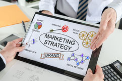 Marketing strategy concept on a clipboard Stock Photos